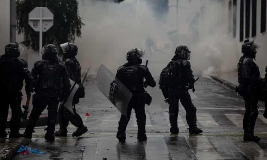 Riot police officers in the streets during demonstrations in Bogotá, Colombia, on 1 May.