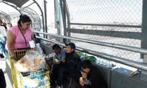 Migrants receive food handouts at the US border
