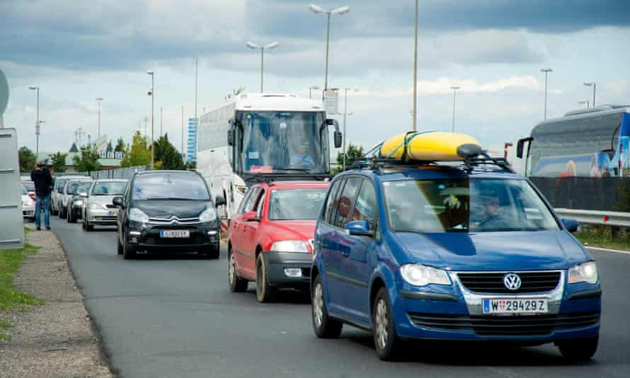 Cars on road at border