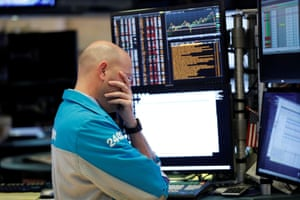 A trader on the floor of the New York Stock Exchange (NYSE) in New York City, New York, U.S., March 11, 2020.