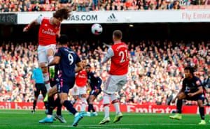 Luiz heads home the opener for Arsenal.