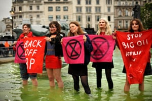 Activists stand in a fountain at the famous London location