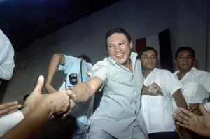 Noriega shakes the hands of followers who attended his birthday party in Panama City in 1988