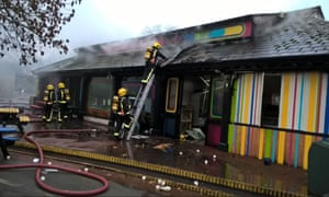 Firefighters tackle the blaze on Saturday morning.