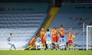 Manchester City's Kevin De Bruyne curls in a free-kick which is saved by Johnstone.