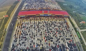 A traffic jam near a toll station in Beijing. Authorities hope t ease the burden on the city with a new metropolis 100 km away.