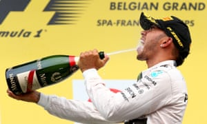 A thirsty Lewis Hamilton on the podium.