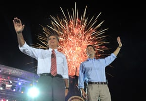 Mitt Romney and his running mate Paul Ryan wave.