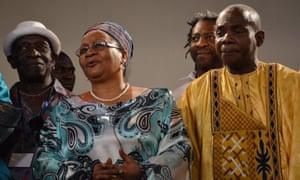 Official approval... Mali's first lady Keita Aminata Maiga with Tony Allen (left) and Toumani Diabaté (right).