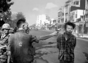 South Vietnamese National Police Chief Brig General Nguyen Ngoc Loan executes a Viet Cong officer with a single pistol shot in the head in Saigon, February 1968