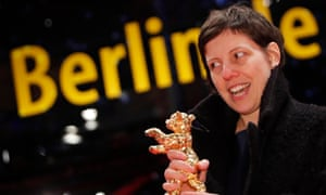 Adina Pintilie poses with her Golden Bear award for Best Film Touch Me Not during the awards ceremony at the 68th Berlinale International Film Festival in Berlin.