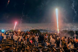 Medellin, Colombia. People watch fireworks during the Alborada, a tradition to celebrate the arrival of the Christmas season