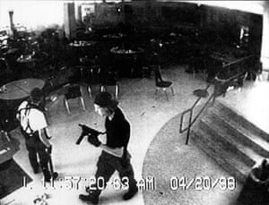 Eric Harris and Dylan Klebold in the school cafeteria during the Columbine High School massacre, in Colorado, 20 April 1999.