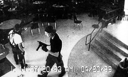A CCTV image of Eric Harris, left, and Dylan Klebold in the school cafeteria during the shooting.