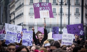 Demonstrators hold placards as they protest during a one day strike to defend women's rights on International Women's Day in Madrid.
