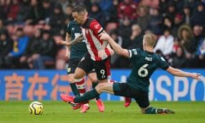 Ben Mee of Burnley fouls Danny Ings of Southampton.