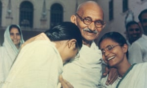 Gandhi with two of his granddaughters, Delhi, 1948.