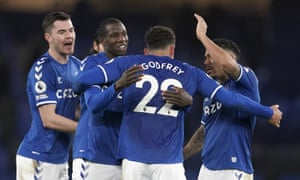 The Everton players celebrate at full-time.