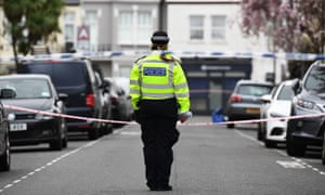 A police officer at the scene in Fulham, west London