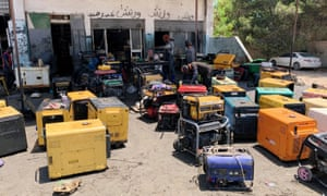 Misrata, Libya: workers fix generators at a workshop during the long-lasting power blackouts
