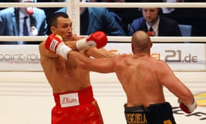 Tyson Fury lands an early blow on Wladimir Klitschko.