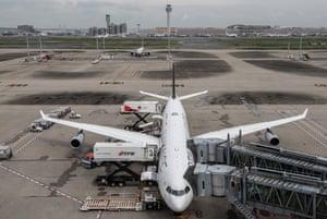An aeroplane is loaded prior to departure from Haneda airport last week.