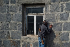 Karvachar, Azerbaijan A man kisses the walls of his home before abandoning it as fear of Azeri persecution prompts him to leave his homeland in Nagorno-Karabakh