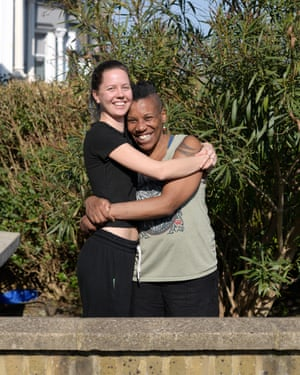 Evering Road residents Karen and Vicky embracing in their garden