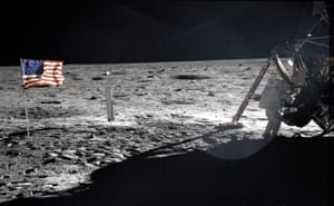 A frame from Aldrin's first panorama shows Armstrong packing samples in an open rock box