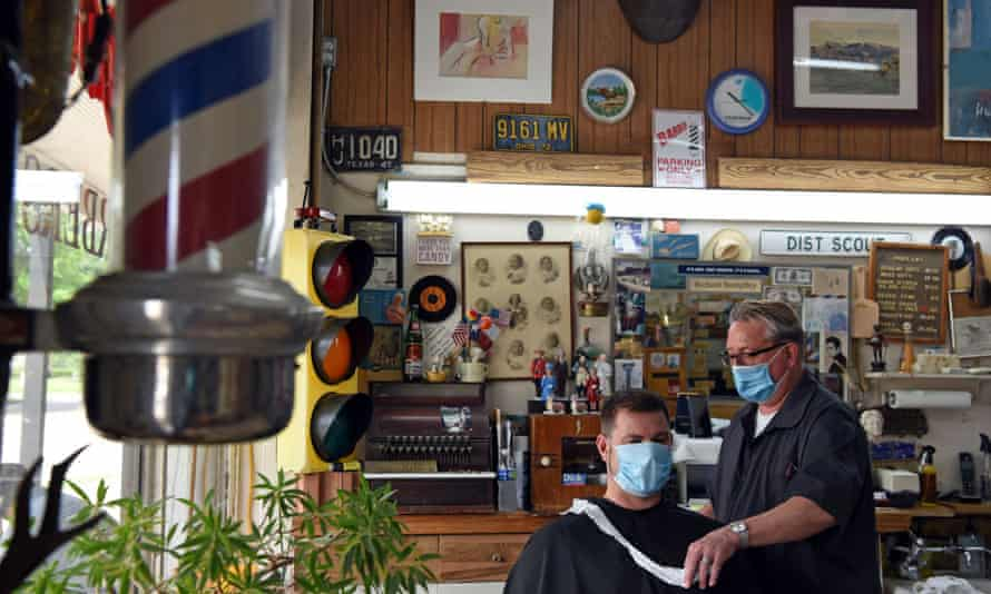 A man gets a haircut at Doug's Barber Shop in Houston. Harris county, which includes Houston, has 157 virus cases per 100,000 people.