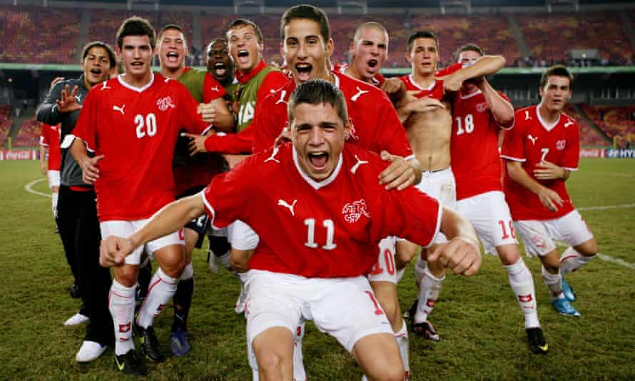 Granit Xhaka, No 11, leads the celebrations after Switzerland beat Brazil in Abuja at the under-17 World Cup in October 2009.