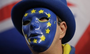 An anti-Brexit demonstrator wears a mask bearing the stars of the European flag outside the Houses of Parliament in London this week