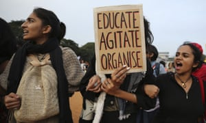 Indian students shout slogans and hold placards during a protest in Bangalore, India.