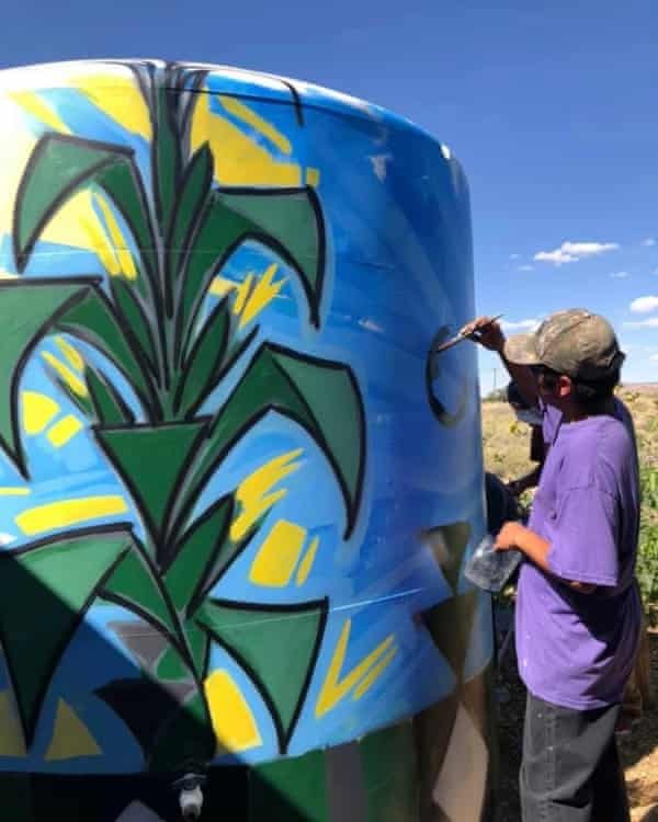 A water tank installed in the Hopi Reservation is painted in bright colors