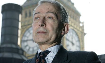 Portrait of  Frank Field with backdrop of House of Commons