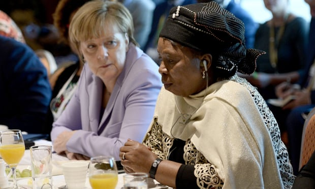 Angela Merkel listens to African Union chairperson Nkosazana Dlamini-Zuma at the EU's Africa summit on migration.
