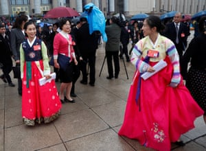 Minority ethnic delegates talk to each other as they leave the Great Hall of the People
