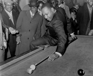 King shows off with a pool cue while in Chicago in 1966 campaigning for better living conditions for African-Americans.