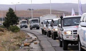 Vehicles carrying food, medicine and blankets, leave the Syrian capital Damascus as they head to the besieged town of Madaya