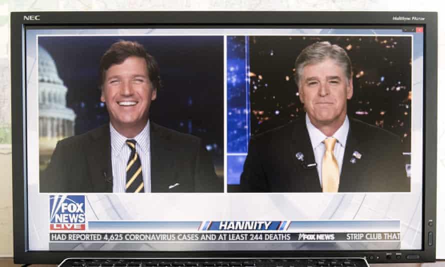 Sean Hannity, right, with fellow Fox News host Tucker Carlson.