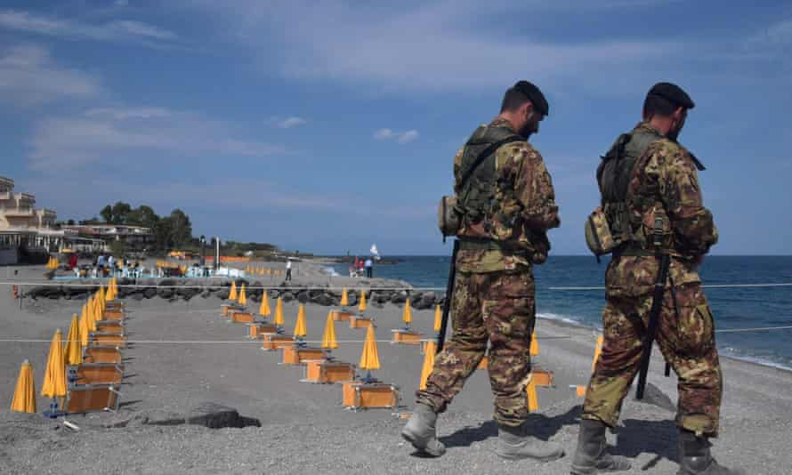 Italian soldiers control access to the beach near the G7 media center in the coastal town of Giardini Naxos, south of Taormina.