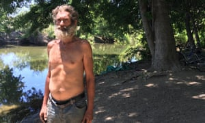 James Donaldson has a tarp, a sick wife, three dogs and 10 bikes by the river, his home for 40 years.
