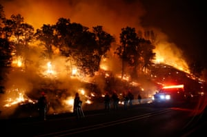 Firefighters with the Marin County fire department's Tamalpais fire crew monitor a backfire as they battle the fire