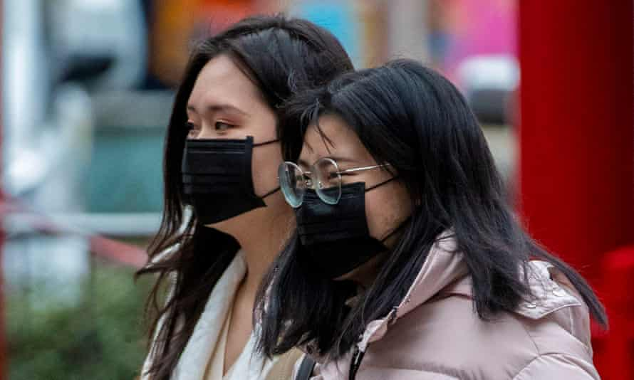 Members of the Chinese community in Manchester wearing face masks. The incidents in Hampshire have led people to fear wearing masks.