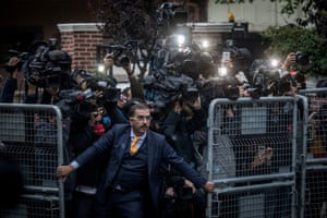 Man tries to hold back press in Istanbul, Turkey.