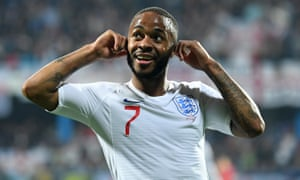 Raheem Sterling  gestures to the Montenegro supporters after scoring a goal