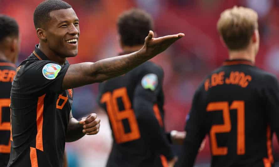 Georginio Wijnaldum shows his delight after scoring the Netherlands' third goal