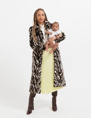 model wears coat, £169.99, mango.com. Roll neck, £113, joie.com. Skirt, £41, arket.com. Boots, £190, dunelondon.com