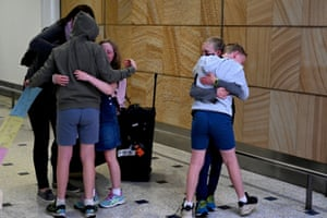 AUSTRALIA-NZEALAND-HEALTH-VIRUSA family reunites upon their arrival from New Zealand at Sydney International Airport on April 19, 2021, as Australia and New Zealand opened a trans-Tasman quarantine-free travel bubble. (Photo by SAEED KHAN / AFP) (Photo by SAEED KHAN/AFP via Getty Images)