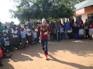 Dixon Kiringo, rapping in a village on Ukerewe during a performance designed to challenge myths and provoke conversations around albinism.